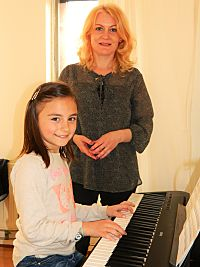 Pianoles cursist Simona